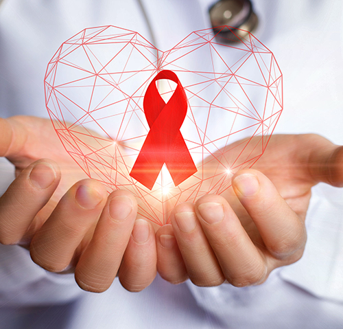 Hands holding heart with AIDS ribbon